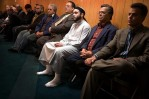 Groom Javier Azhar Graviz, 24, third from right, listens with other Hispanic men to the spiritual leader Imam Mohammed Al-Hayek speak about marriage just before Graviz's Islamic marriage ceremony at Bergen County Islamic Center in Hackensack, New Jersey, Nov. 18, 2006. Graviz met his future wife on Islamic chat room. Graviz, who was born in Uruguay and attended Roman Catholic school, converted to Islam seven years ago.