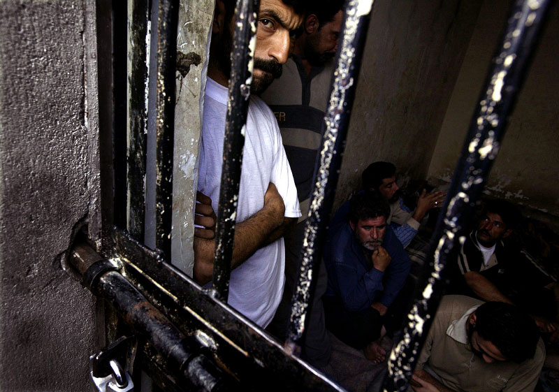 In Basra, the escalating crime problem has led to the packed prison cells, such as this one holding 30 inmates, Sunday, March 21, 2004. Many residents say the local police and British troops patrolling the southern port city are ineffective, not only against religious militias, but also against street crime.
