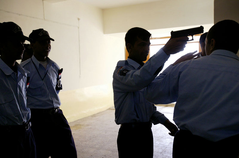Iraqi Police recruits train to defend themselves at Basra Police Station in Basra, Iraq. Fighters opposed to the U.S. led government are repeatedly targeting Iraqi policemen and Iraqi security forces.