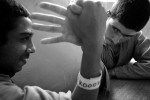 Hussein Ali, 13, left, and Muhamad Nader, 14, arm wrestle at Iraqi Juvenile Prison in Baghdad, Iraq. The inmates are not allowed to have any games or books in their cell.