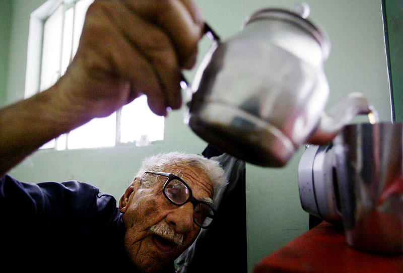 Hasoon Sayeed, 83, who has lived at a nursing home in Baghdad for the past two years, drinks tea in his room. Sayeed used to work as a psychologist in Baghdad. Sayeed says that for the past year conditions at this nursing home have worsened. Seniors now receive only about $5 a month from humanitarian organizations and under Saddam Hussein they used to receive about $80 a month.