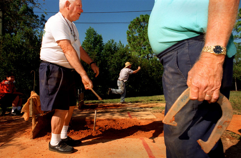 Elmer Prentice plays horseshoes at the Karl J. Drews Community Center in San Carlos Park, Florida. Prentice and his friends have been meeting there for the  past four years to play horseshoes several times a week.