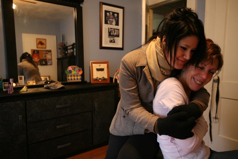 Sgt. Matthew Fenton's girlfriend Andrea Patino, 25, left, hugs his mother Diane Fenton, 50, in his room at their home in Little Ferry, New Jersey, Saturday, Feb. 24, 2007.