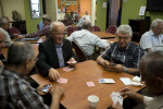 Iraqi refugees play cards, backgammon and socialize at an EMASS/UPAC community center. Older refugees have a difficult time adjusting to their new life in the United States. It is often too late for them to start over again, it is more difficult for them to learn the language, to adopt to a new culture and they remain attached to the life and community that they left behind, especially the social life with their family, neighbors and friends. As a result, they often feel marginalized and useless. El Cajon, CA, USA.