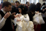 Iraqi families baptize their children during a ceremony at the Saint George Chaldean church. A new generation of Iraqis are being born in the growing Iraqi community in the United States.Shelby Township, MI, USA.