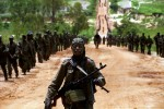 FAA (Forca Armada Angolana) soldiers on a patrol during military operations against UNITA rebels. Following several failed peace initiatives, the government mounted a major offensive against Jonas Svimbi's UNITA in the eastern province of Moxico in an attempt to end decades of civil war by military means.Luena, Angola.Photo © J.B. Russell