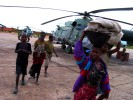 Civilians evacuated by helicopter from UNITA held areas as the government army advanced. During the Angolan government's decisive offensive against UNITA in the eastern province of Moxico, where rebel leader Jonas Savimbi was eventually killed, the government conducted a scorched earth strategy of displacing the civilian population, putting them in rudimentary camps and burning fields and villages to flush out the rebels. This strategy added to the millions of people already displaced by years of war and provoked a serious famine in many parts of the country.Luena, Angola.Photo © J. B. Russell