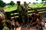 Civilians from UNITA held areas being brought by government soldiers to the advanced command post. During the Angolan government's decisive offensive against UNITA in the eastern province of Moxico, where rebel leader Jonas Savimbi was eventually killed, the government conducted a scorched earth strategy of displacing the civilian population, putting them in rudimentary camps and burning fields and villages to flush out the rebels. This strategy added to the millions of people already displaced by years of war and provoked a serious famine in many parts of the country.Luena, Angola.Photo © J.B. Russell