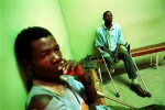 Landmine victims waiting at the Vietnam Veterans Association Foundation (VVAF) workshop to have prosthetic limbs fitted. Despite vast reserves of petroleum, diamonds and natural resources, decades of fighting between FAA (Forca Armada Angolana) forces and UNITA rebels have riddled Angola with land mines, impoverishing and crippling its people.Luena, Angola.Photo © J.B. Russell