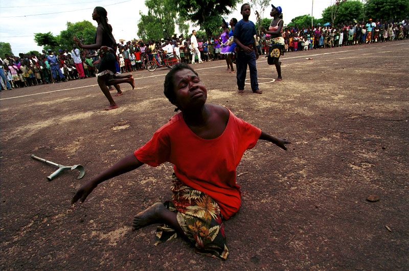 A landmine victim dances during festivities for the International Day of the Disabled. In a country that has been wracked by decades of civil war, this day takes on particular significance. Despite vast reserves of petroleum, diamonds and natural resources, decades of fighting between FAA (Forca Armada Angolana) forces and UNITA rebels have riddled Angola with landmines, impoverishing and crippling its people.Luena, Angola.Photo © J.B. Russell