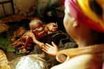 A mother with her severely malnourished children at a MSF therapeutic feeding center. The military strategies of the government armed forces and UNITA rebels toward the civilian population caused widespread devastation and a serious famine situation in the country. Aid organizations have had access to large portions of the country only after a cease-fire was signed in April 2002.Bailundo, Angola.Photo © J.B. Russell