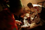 A severely malnourished child is treated at a MSF therapeutic feeding center. The military strategies of the government armed forces and UNITA rebels toward the civilian population caused widespread devastation and a serious famine situation in the country. Aid organizations have had access to large portions of the country only after a cease-fire was signed in April 2002.Bailundo, Angola.Photo © J.B. Russell