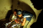 A medical technician examines a child suffering from severe malnutrition in the intensive care unit at a MSF therapeutic feeding center. The military strategies of the government armed forces and UNITA rebels toward the civilian population caused widespread devastation and a serious famine situation in the country. Aid organizations have had access to large portions of the country only after a cease-fire was signed in April 2002.Bailundo, Angola.Photo © J.B. Russell