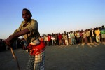 Demobilized UNITA soldiers sing and dance {quote}La Rumba{quote} at a dawn assembly in their quartering area. 4045 demobilized soldiers and their 25,000 family members live in the quartering area waiting to be integrated into the government armed forces or to return to civilian life.Sambo, Angola.Photo © J.B. Russell