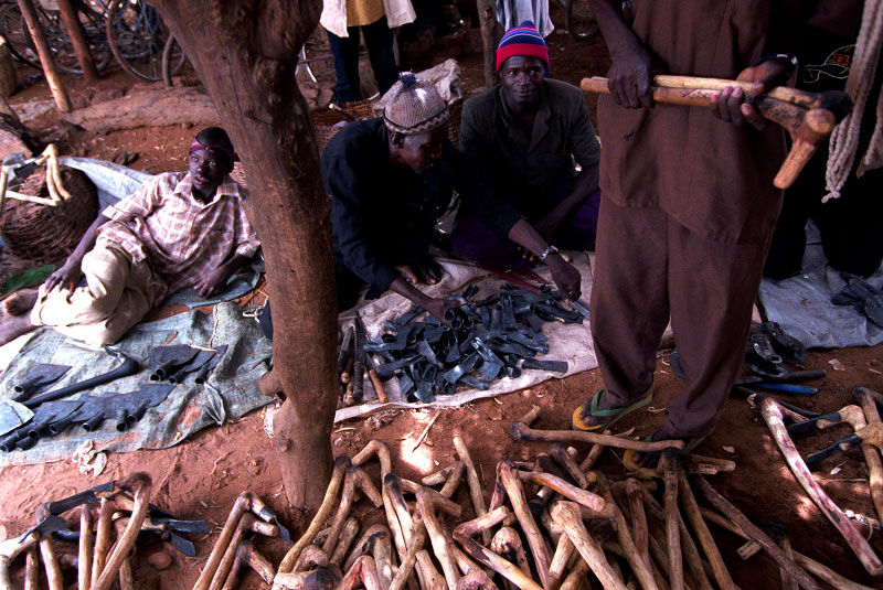 Pickaxes made from tree branches and hand forged metal for sale in the local market. Agricultural work in Burkina Faso is entirely manual.Zitenga, Burkina Faso.Photo © J.B. Russell