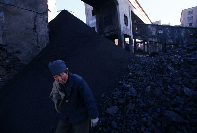 A worker at the state run Jinhuagong coalmine sorts coal. While large, state run mines are better operated, China's insatiable demand for energy has allowed thousands of independent, unregulated mines to flourish. These mines rarely observe safety and environmental standards.Dàtóng, Shanxi Province, China.Photo © J.B. Russell
