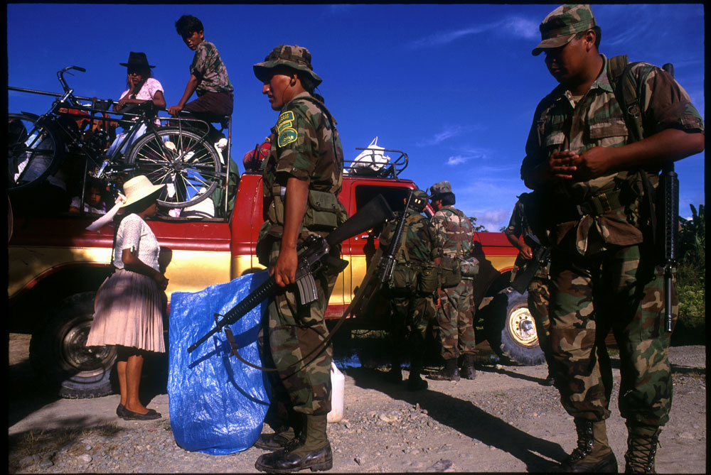 Special narcotics forces (UMOPAR) search a truck for drugs and drug making materials along a rural road.  El Chapare, in Bolivia's central lowlands, is the country's principle coca producing region and the heart of the war on drugs.El Chapare, Bolivia.Photo © J.B. Russell