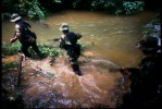 Special narcotics forces (UMOPAR) on a jungle patrol searching for drug labs.  El Chapare, in Bolivia's central lowlands, is the country's principle coca producing region and the heart of the war on drugs.El Chapare, Bolivia.Photo © J.B. Russell