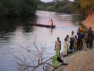Villagers wait to cross a river by dugout canoe. Vast and enormously rich in natural resources, Congo has almost no paved roads or infrastructure. The country's river system is the primary means of transportation.Katanga Province, DR Congo.Photo © J.B. Russell