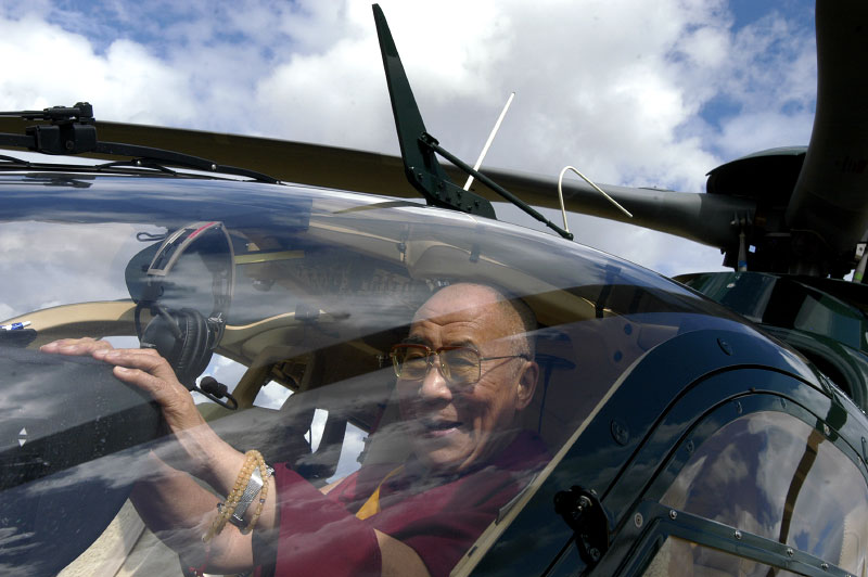 His Holiness the Dalai Lama departing from the Vajradhara Ling Buddhist Temple in Normandie by helicopter during his visit to France. The Dalai Lama blessed a project to build a Temple for Peace at the center and gave a speech to hundreds of guests.Aubry-le-Panthou, France.Photo © J.B. Russell