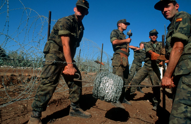 Spanish soldiers building a barrior around the Spanish enclave of Ceuta, along the north coast of Morocco, to prevent illegal immigrants from using the Spanish territory as a jumping off point on their way to the open borders of Europe.Ceuta, Spain.Photo © J.B. Russell