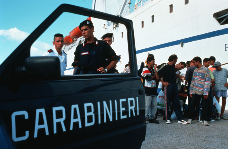 North African and Iraqi Kurds who were apprehended by the Italian Coast Guard on a boat originating from Tunisia attempting to enter Italian territorial waters around the Mediterranian island of Lampadusa. The immigrants seeking a better life or asylum in Europe are taken to a detention center on the Italian mainland.Lampadusa, Italy.Photo © J.B. Russell