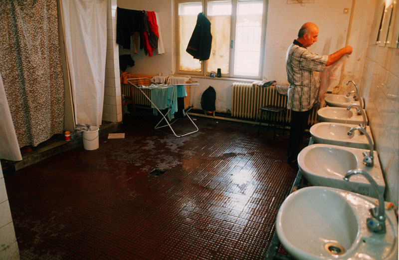 An Illegal immigrant washes his clothes in the communal bathroom of a detention center on a military base after being expelled from Austria. The new eastern members of the European Union, for decades countries of emigration, are now on the front lines of the fight against illegal immigration into the open borders of Europe, but have few means of dealing with the problem.Györ, Hungary.Photo © J.B. Russell