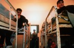 Illegal immigrants in a detention center on a military base after being expelled from Austria. The new eastern members of the European Union, for decades countries of emigration, are now on the front lines of the fight against illegal immigration into the open borders of Europe, but have few means of dealing with the problem.Györ, Hungary.Photo © J.B. Russell