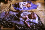 Infant twins suffering from extreme malnutrition lie in a hut in a remote settlement waiting for humanitarian aid to reach the drought stricken region of Ogaden. Bergun, Ethiopia.Photo © J.B. Russell