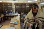 Men studying the Torah during a Kollel (religious study group) in a small library inside the Tomb of the Partriarchs (Ma'arat HaMachpela).Hebron, Israeli Occupied Palestinian Territories. Photo © J.B. Russell