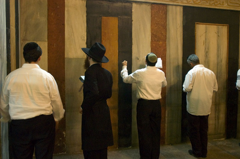 Jewish worshipers praying in the Issac hall of the Tomb of the Patriarchs (Ma'arat HaMachpela) during the Haye Sarah Shabbat. The majestic prayer hall, and other parts of the site are only accessible to Jews ten days during the year for special occations. Thousands of Jews, including a large number of settlers, come to Hebron for the highly symbolic event during which the story where Abraham purchases land and a cave in order to bury his wife Sarah, and subsequently himself and his decendents, is read from the Torah. The Tomb of the Patriarchs is said to stand on the site. Some six hundred Jews live in the heart of Hebron's old city surrounded by over 160,000 Palestinian inhabitants.Hebron, Israeli Occupied Palestinian TerritoriesPhoto © J.B. Russell