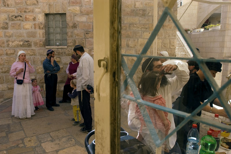Family members and friends gather for a new born boy's Brit Milla circumcision ceremony in Hebron's Jewish community.Hebron, Israeli Occupied Palestinian Territories. Photo © J.B. Russell