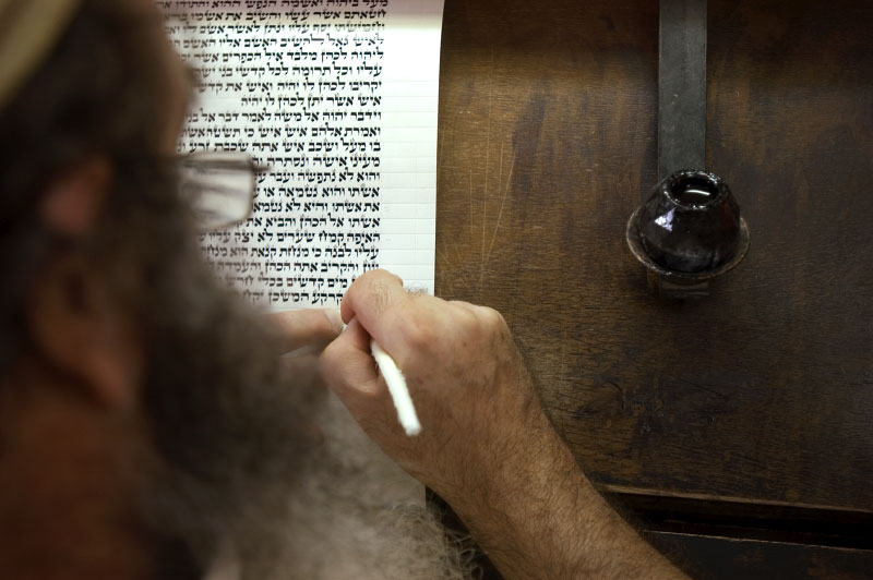 A Jewish resident of Hebron transcribes the Torah by hand for use in prayer and synagogues. It takes approximately ten months to copy the entire text of the Torah.Hebron, Israeli Occupied Palestinian Territories. Photo © J.B. Russell