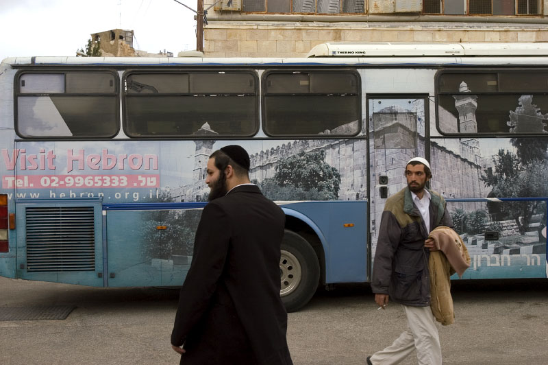A tour bus bringing Jewish tourists to the Tomb of the Patriarchs and Hebron's Jewish community.Hebron, Israeli Occupied Palestinian Territories. Photo © J.B. Russell