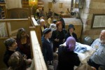 Women receive a new born boy following his Brit Milla circumcision ceremony in the Jewish part of the Tomb of the Patriarchs.Hebron, Israeli Occupied Palestinian Territories. Photo © J.B. Russell