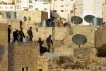 Israeli special forces search the rooftops of Palestinian homes surrounding the Jewish community in Hebron. Approximately 600 Jewish settlers live in the historic center of the city which has a Palestinian population of more than 160,000.Hebron, Israeli Occupied Palestinian TerritoriesPhoto © J.B. Russell