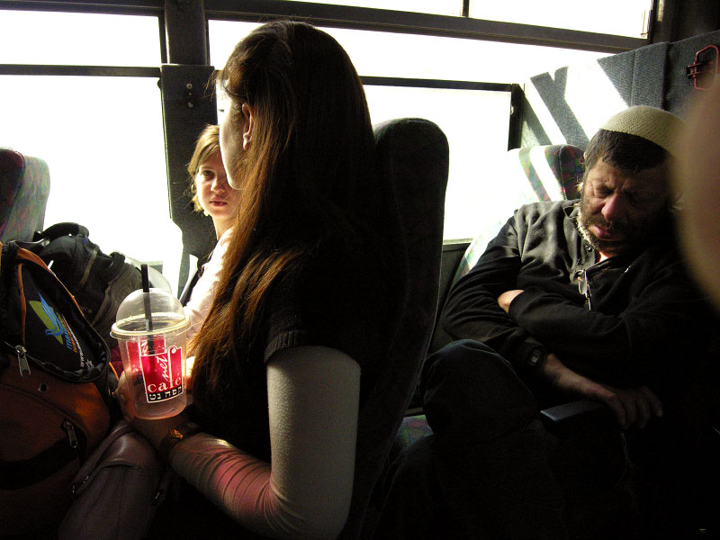 Passangers on a special bus with armored windows travelling from Jerusalem to Hebron as well as other West Bank Jewish settlements.Jerusalem, Israel.Photo © J.B. Russell