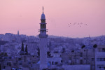 Minerettes over the Amman cityscape at sunset.Amman, Jordan.Photo © J.B. Russell