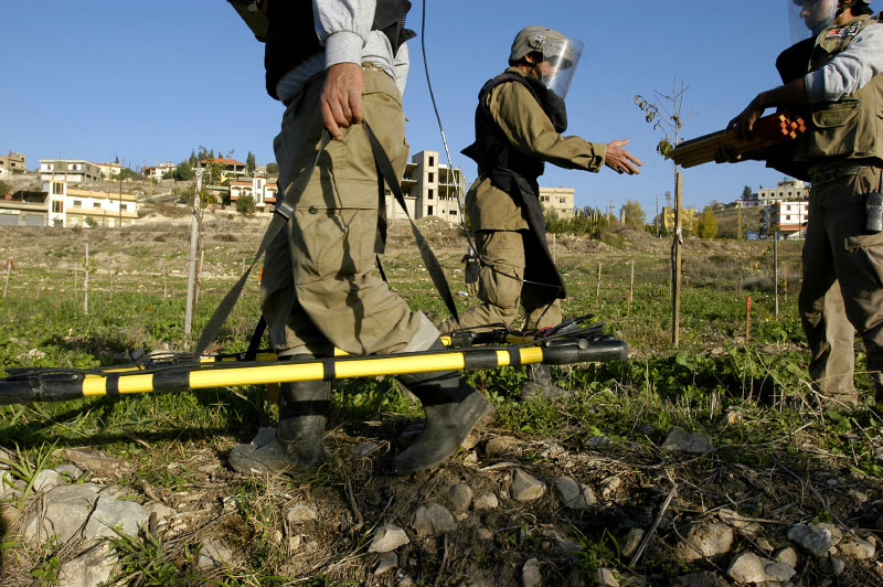 Deminers from Mines Advisory Group (MAG) clearing some of the millions of cluster sub-munitions and other remnants of war scattered across southern Lebanon.Aadchit, Lebanon.Photo © J.B. Russell