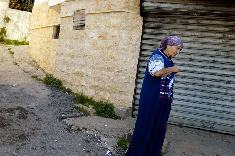 A woman who's husband was killed in Lebanon's civil war and whose land was mined, rendering it unusable, in the Chouf mountains.Bsaba, Lebanon.Photo © J.B. Russell