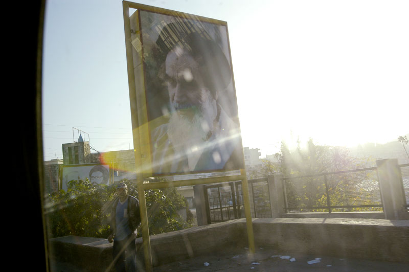 A billboard bearing a portrait of the Ayatollah Khomeini in the Hezbollah stronghold of southern Lebanon. Hundreds of thousands of sub-munitions lie scattered across southern Lebanon following the 2006 Hezbollah - Israel war. Nabatieh, Lebanon.Photo © J.B. Russell