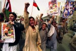 Pro taliban demonstrators run through the streets toward a large rally against American intervention in Afghanistan and Pakistani president President Musharraf's support of the US.Quetta, Pakistan. Photo © J.B. Russell