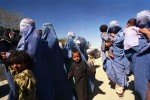 Afghan women and children arrive in Pakistan as the US continues bombing missions in the Taliban stronghold of Kandahar and other targets in Afghanistan.Chaman, Afghan-Pakistan border.Photo © J.B. Russell