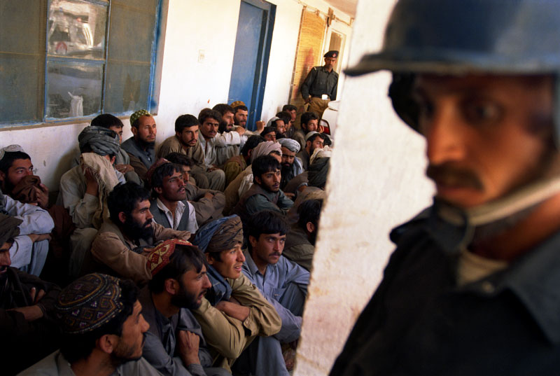 Pakistani troops in the town of Kuchlak, 20 kms from Quetta, guard detained men after demonstrators ransacked several buildings and attacked the police station. The demonstrators say that they were onlookers and did not partake in the demonstrations.  Police shot and killed 3 people during the disturbances.Kuchlak, Pakistan. Photo © J.B. Russell