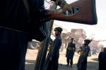 Pakistani troops maintain calm in the streets of Quetta a day after demonstrators ransacked and burned several buildings protesting US attacks on Afghanistan and the Pakistani government's support of the United States. Quetta, Pakistan. Photo © J.B. Russell