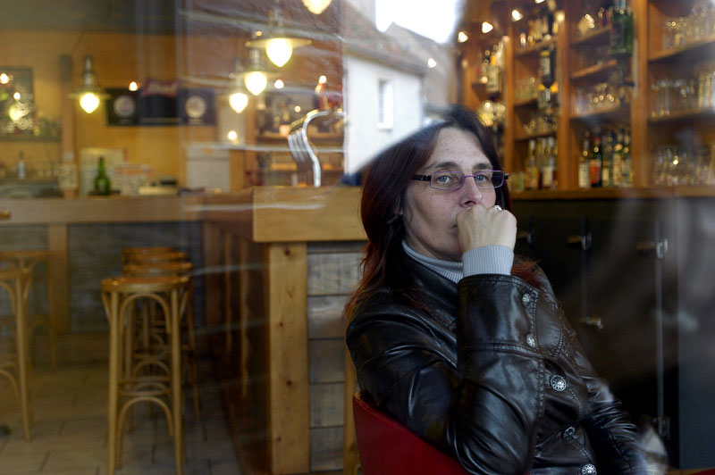 Nathalie Guérin, owner of Café Le FestiVal, is faced with closure as business declines and café culture in France dwindles.Saulieu, France.Photo © J.B. Russell