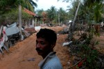 A victim of the December 26, 2004 Tsunami returns to his devastated neighborhood from displaced person's camps to start the process of clearing away the debris and picking up the pieces of his shattered life.Batticaloa, Sri Lanka.Photo © J.B. Russell