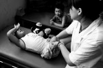 Chun Rui Xia, 8, left, cries as a nurse massages her amputated leg, July 2008. 21 of her classmates were killed due to the earthquake.