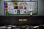 A desk is seen at Liuhe community school damaged by the earthquake, Sichuan, China May 2008. 