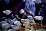 Uighur men receive free meal at mosque at the break of  Ramadan in Khotan, Xinjiang province in China, August, 2010. Government concerns about the radicalizing influence of Islam play out through a raft of religious restrictions, including strict limits on the number of Uighurs who can travel to Mecca, Saudi Arabia, for the annual pilgrimage and rules that force students and government workers to eat during the monthlong fast of Ramadan.